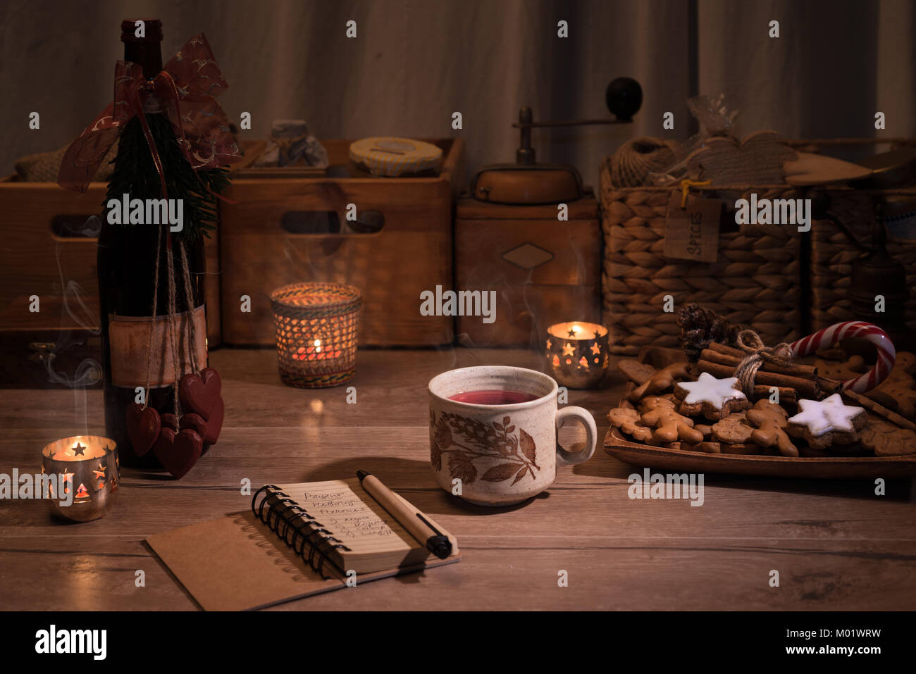 Christmas kitchen with mulled wine and cookies on the table - Stock Image