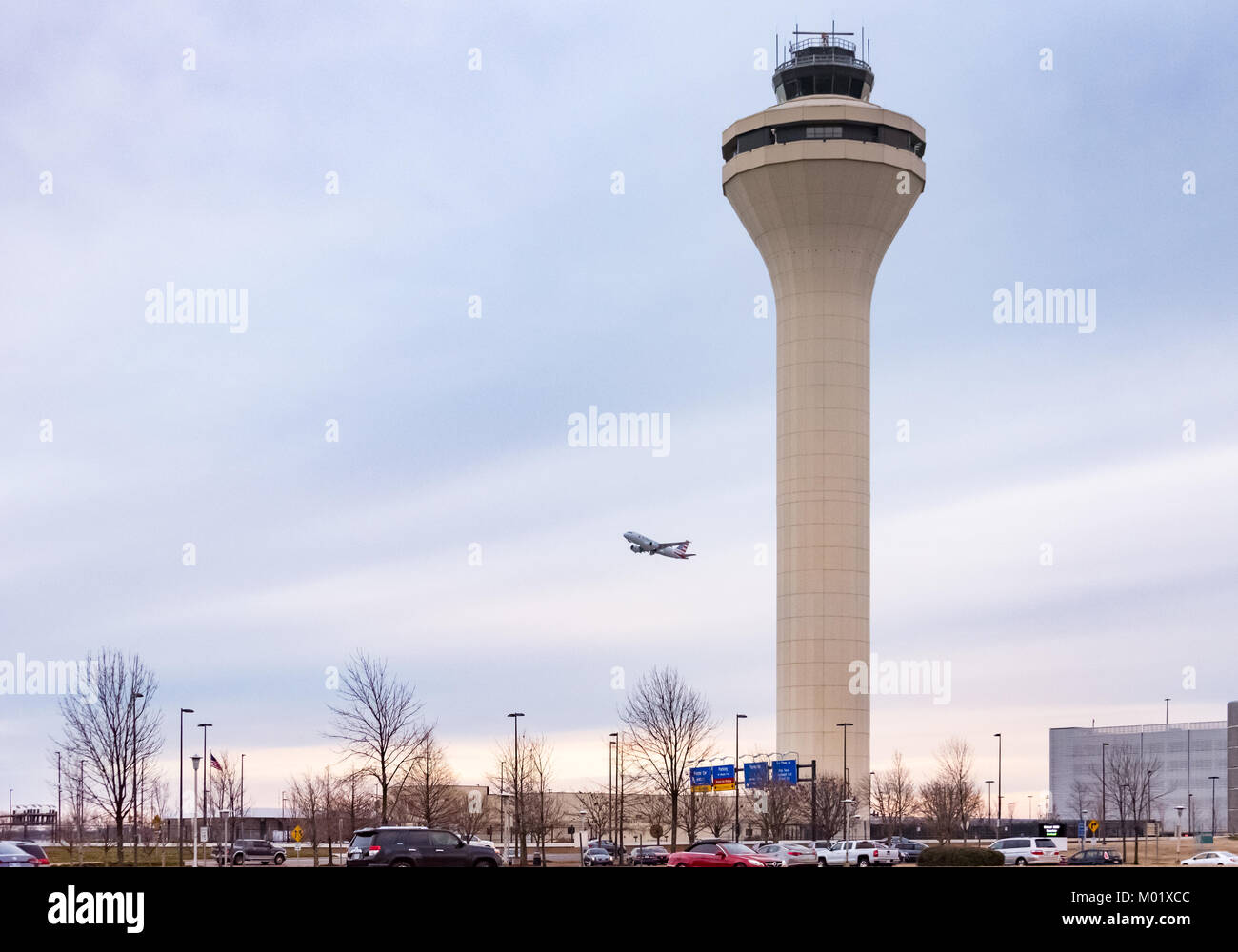 American Airlines jet takes off at dusk from Memphis International Airport in Memphis, Tennessee, USA. - Stock Image
