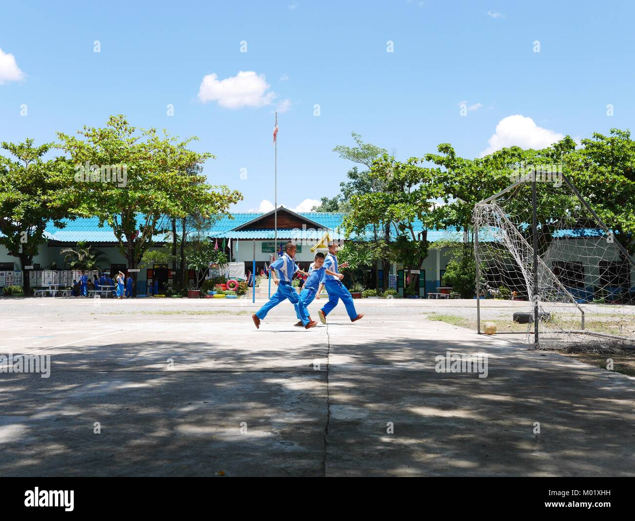 Thai students playing football - Stock Image