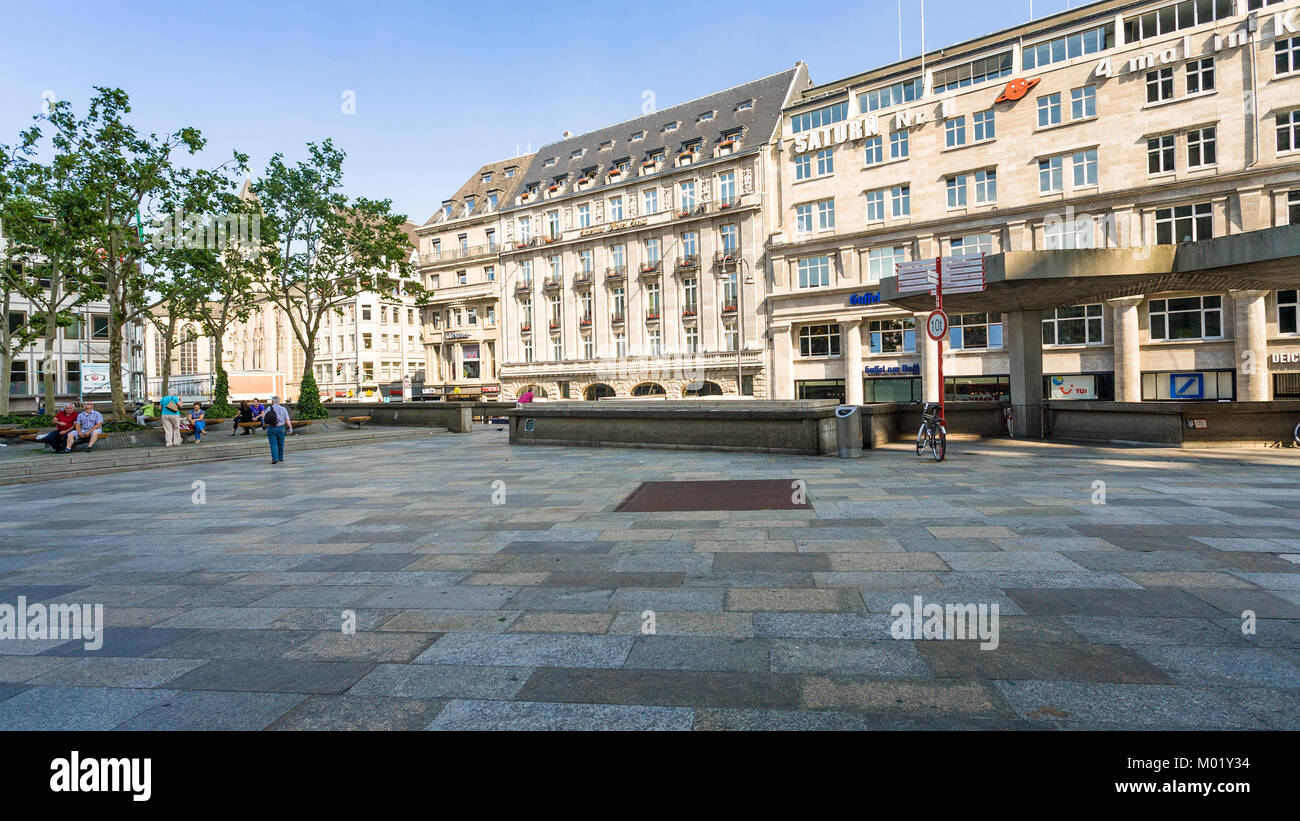 COLOGNE, GERMANY - JUNE 27, 2010: tourists on Domkloster square of Cologne Cathedral in summer day. The Cathedral Stock Photo