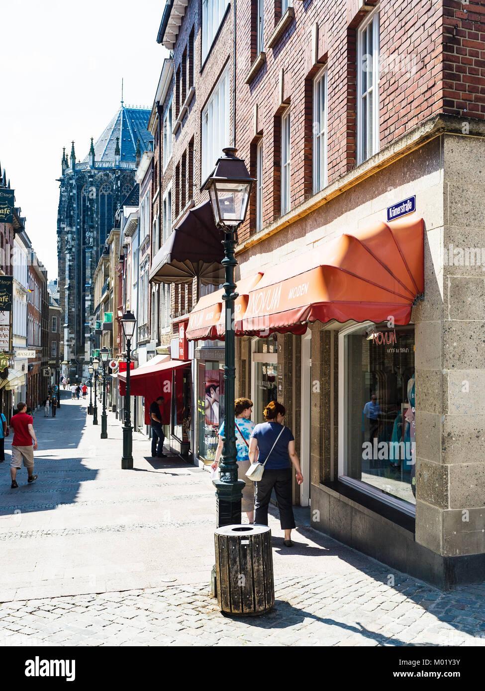 AACHEN, GERMANY - JUNE 27, 2010: people on Kramerstrasse street in historic center of Aachen city in summer. Aachen - Stock Image