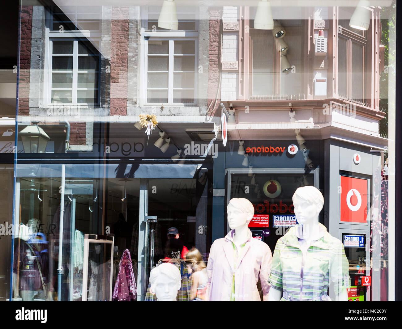 AACHEN, GERMANY - JUNE 27, 2010: reflection in the shop window on Kramerstrasse street in Aachen in summer. Aachen - Stock Image