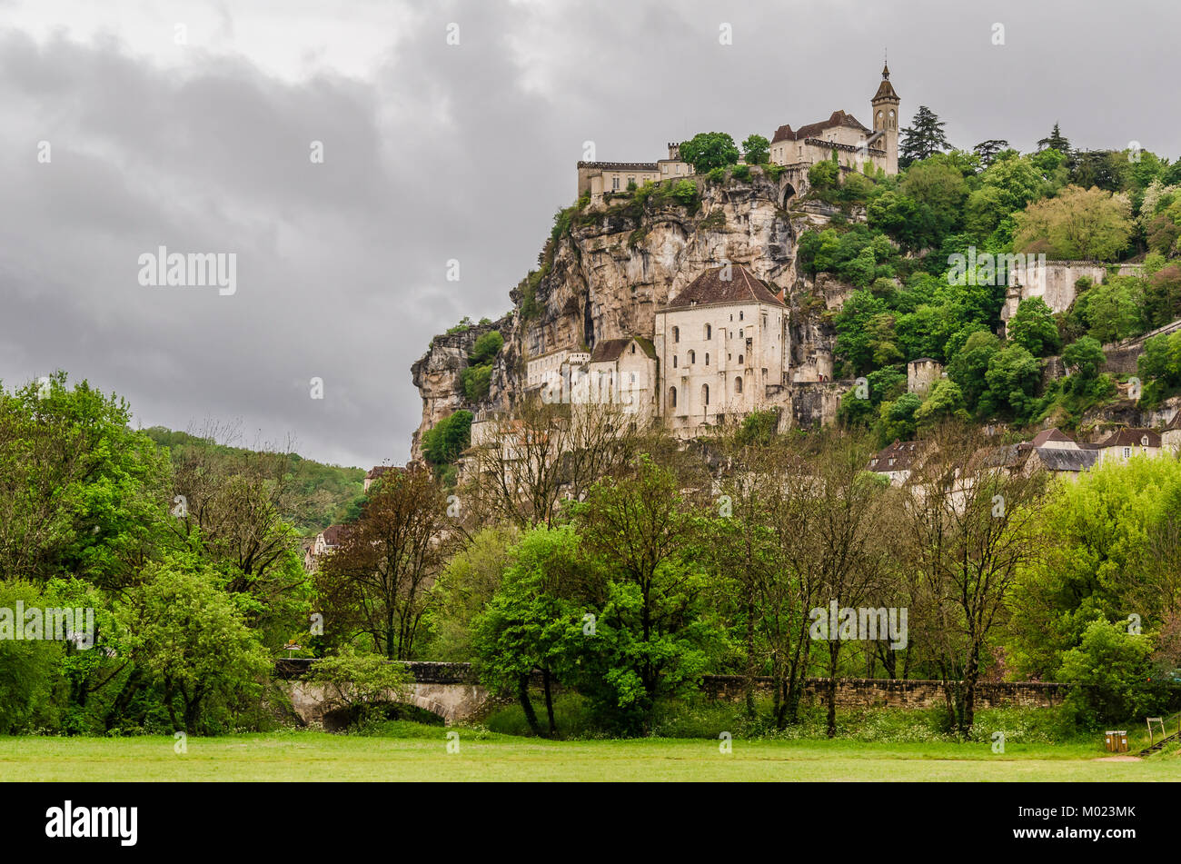 View of the medieval village of Rocamadour in the midi pyrenees region. It is located on top of a calcareous mountain - Stock Image