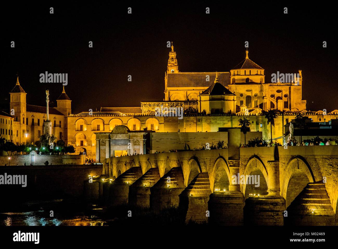 CORDOBA, ANDALUSIA / SPAIN - OCTOBER 14 2017: NIGHT VIEW ON OLD ROMAN BRIDGE Stock Photo