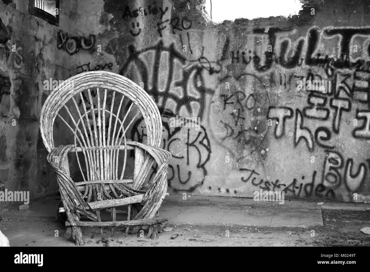 Wicker chair in abandoned jail - Stock Image