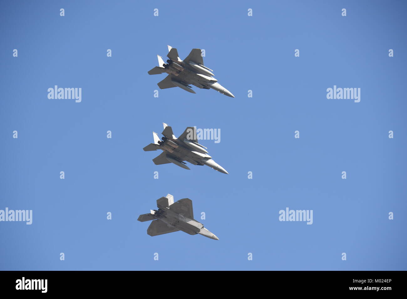 Two U.S. Air Force F-15C Eagle fighter jets from California Air National Guard's 144th Fighter Wing return to base - Stock Image