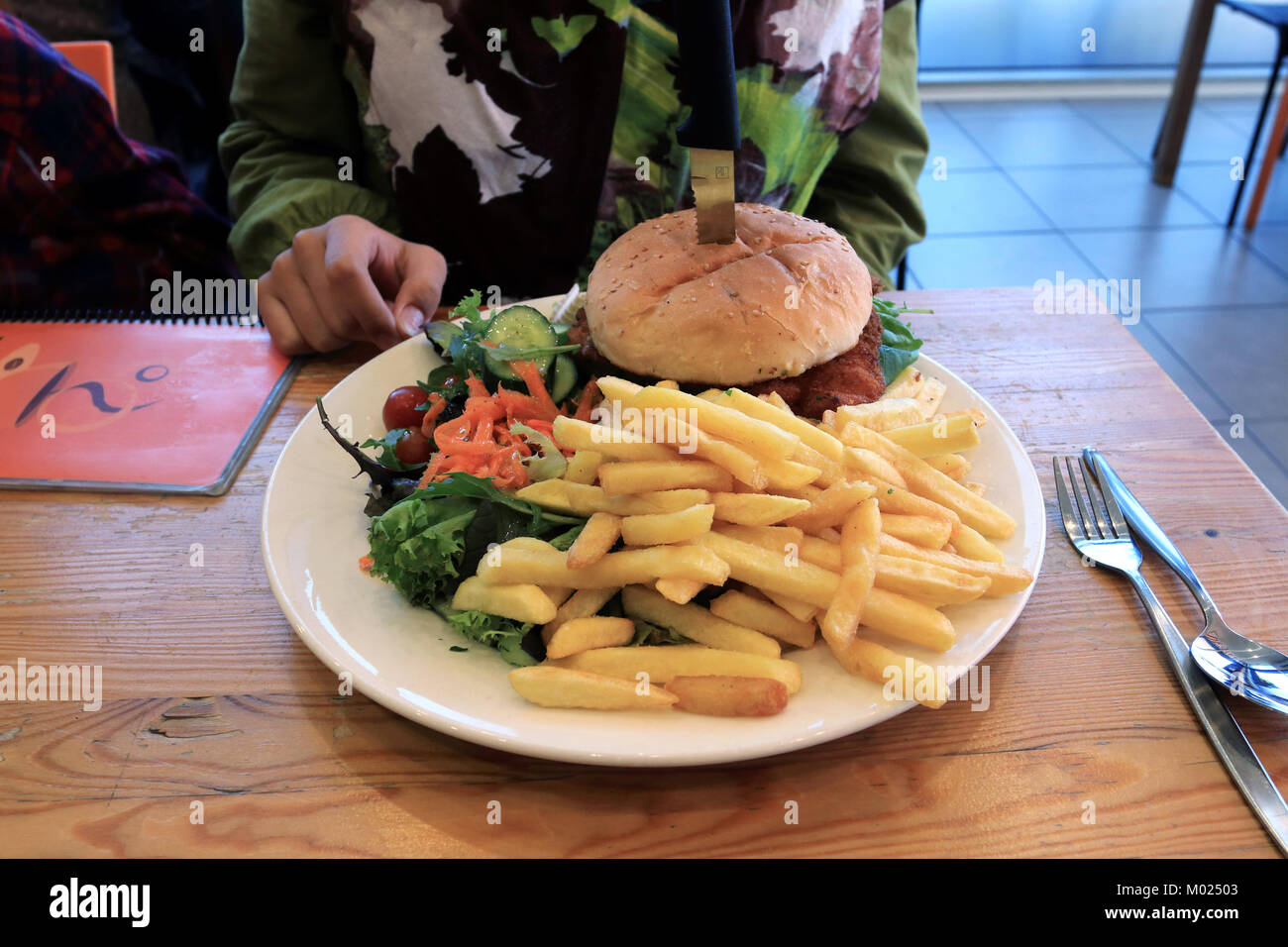 Chicken Schnitzel Burger With Fresh Salad And Chips On A White Plate Stock Photo Alamy