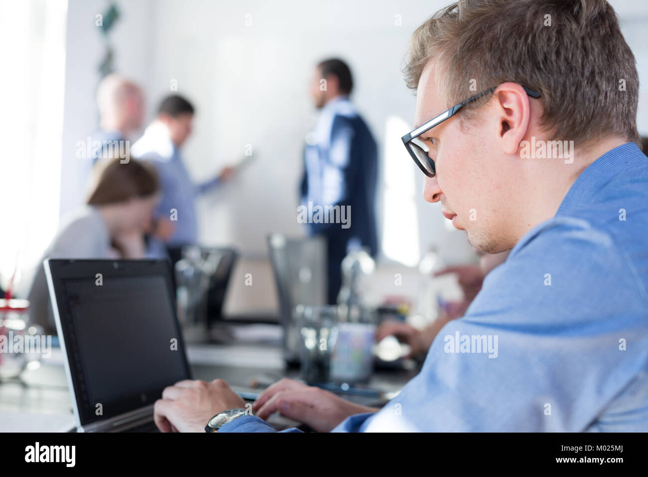 Relaxed informal IT business startup company team meeting. - Stock Image