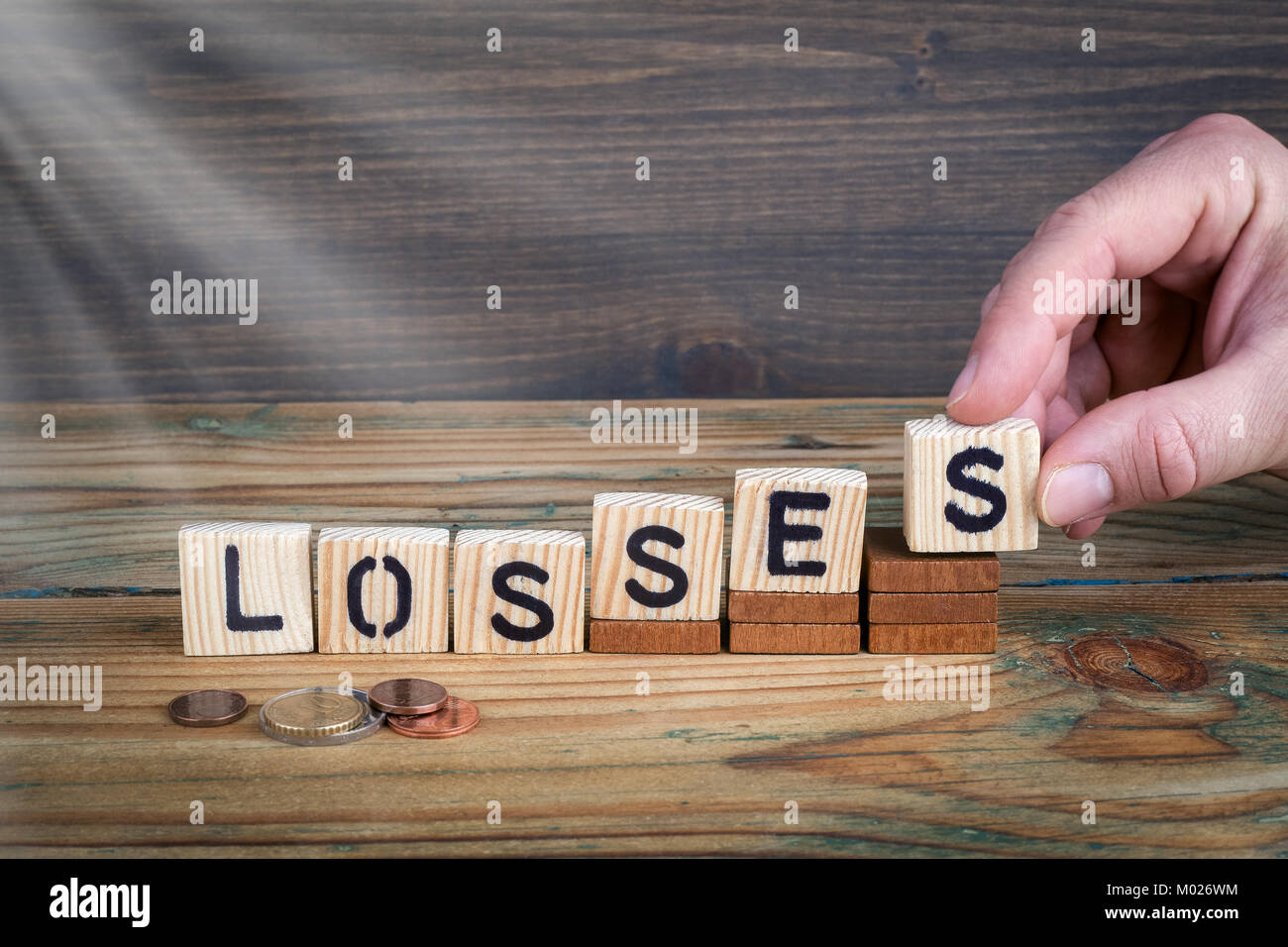 losses. Wooden letters on the office desk, informative and communication background - Stock Image