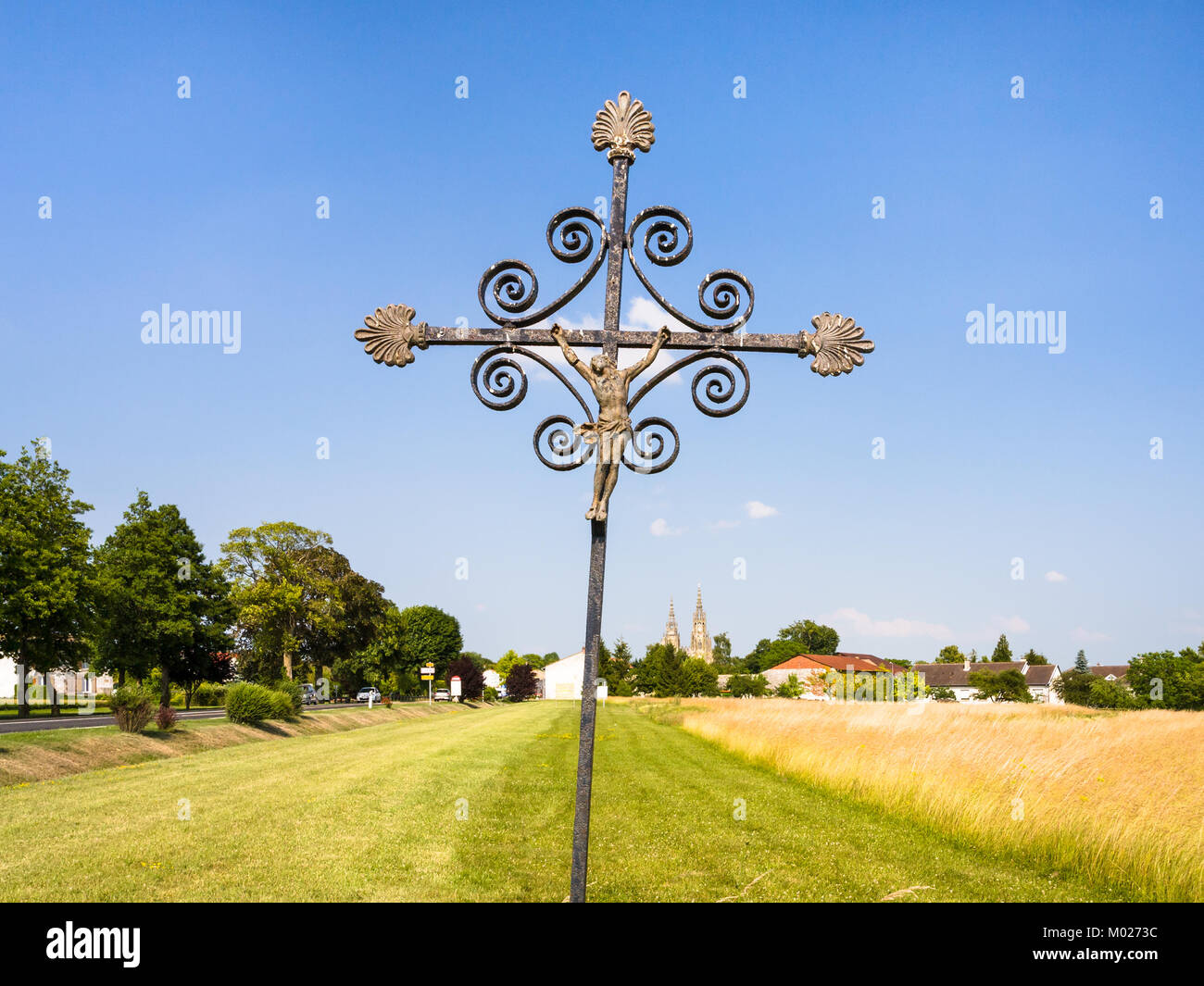 travel to France - old Christian cross in cereal field near commune L'Epine Marne in sunny summer day in Champagne - Stock Image