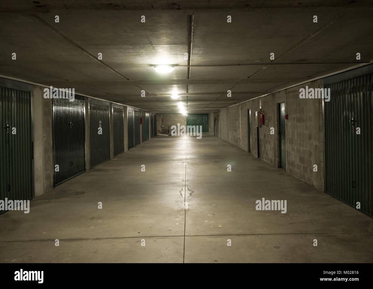 empty parking underground interior, neon lights at night - Stock Image