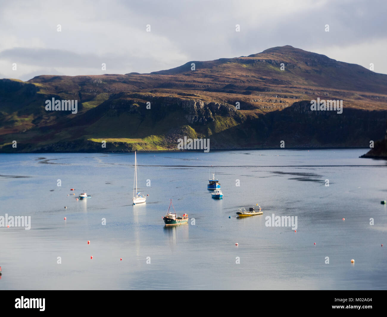 Portree Harbour with boats - Stock Image