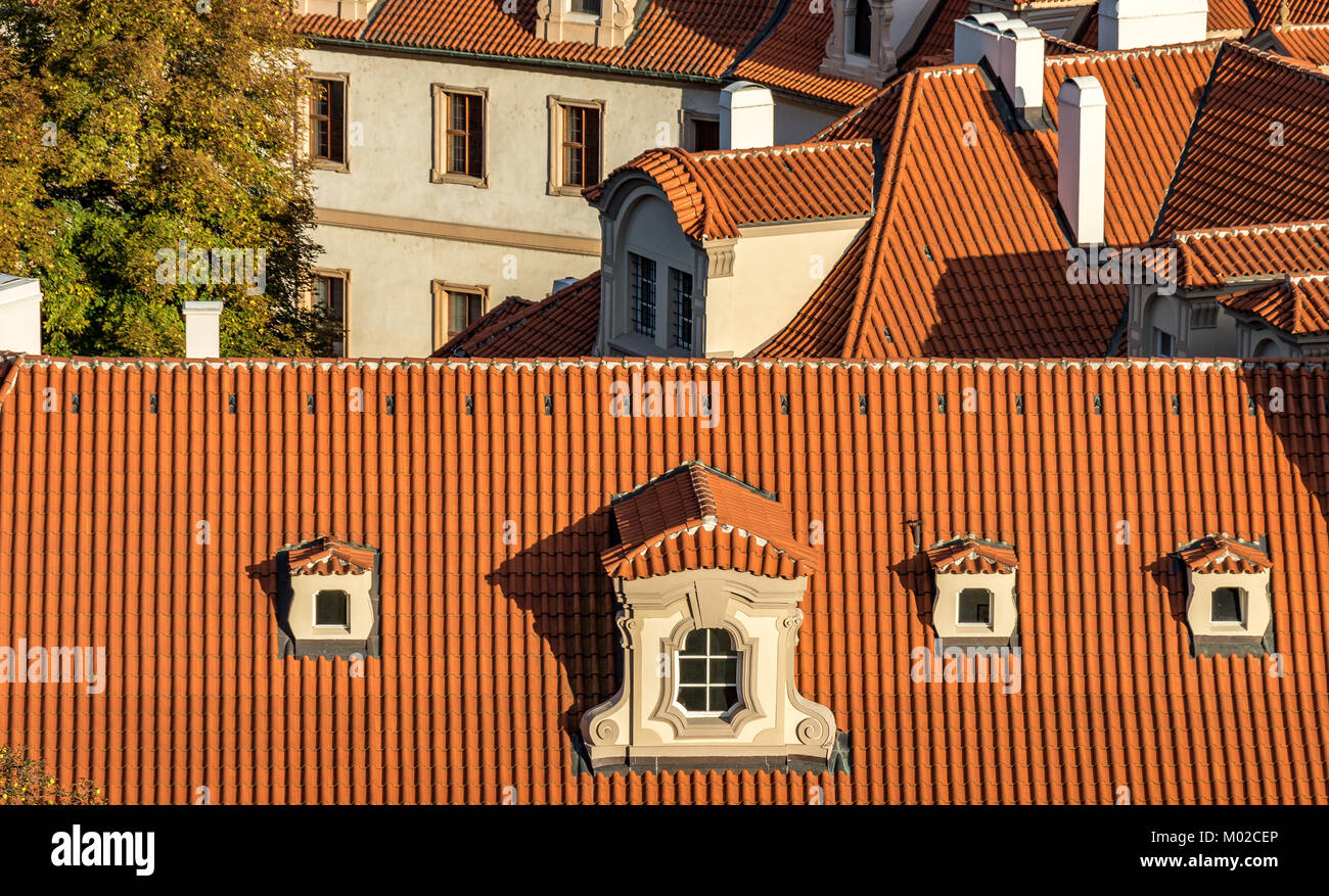 Close Up Of red tiled roofs in afternoon sunlight  from Prague Castle Prague , Czech Republic - Stock Image