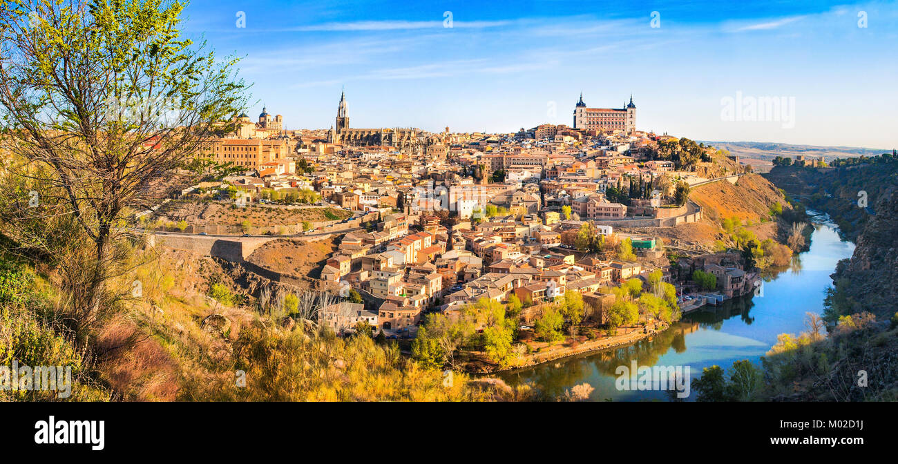 Panoramic view of the historic city of Toledo with river Tajo at sunset in Castile-La Mancha, Spain Stock Photo