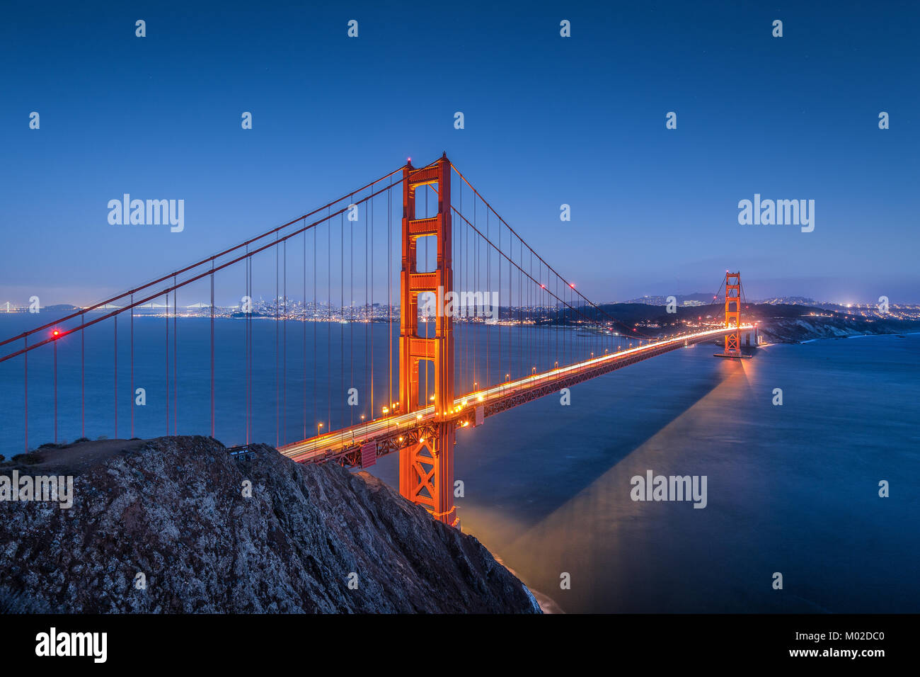 Classic panoramic view of famous Golden Gate Bridge seen from famous Battery Spencer viewpoint in beautiful post - Stock Image