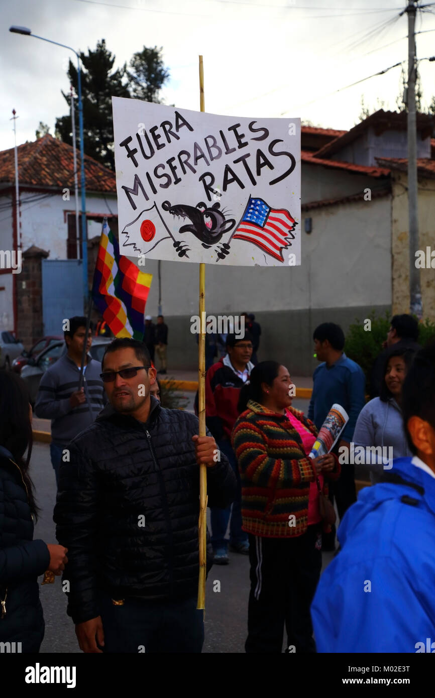 A protester carries a placard protesting against political corruption during a protest march, Cusco, Peru - Stock Image