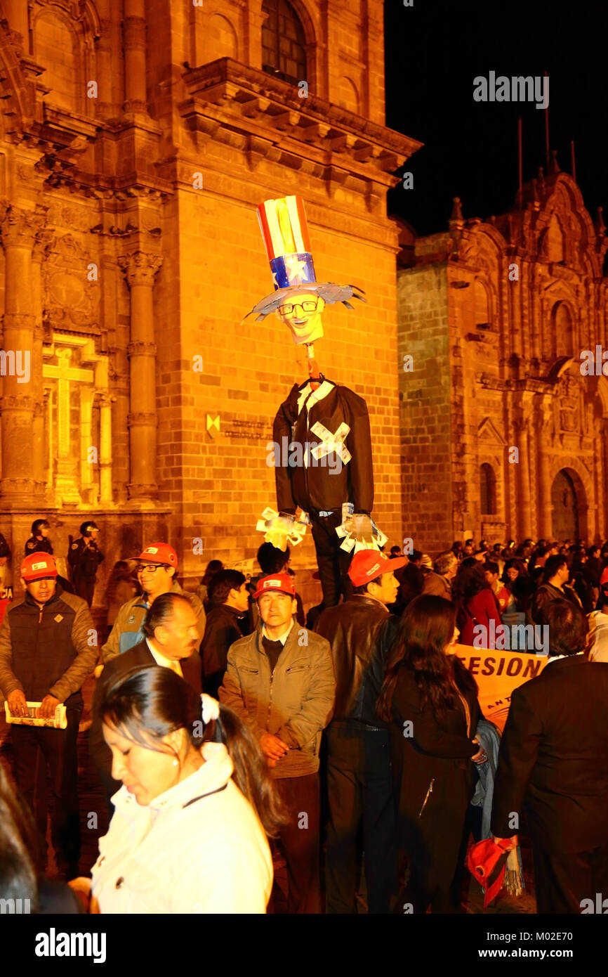 Protesters carry an effigy of Peruvian President Kuczynski during a protest against pardon granted to Alberto Fujimori, - Stock Image