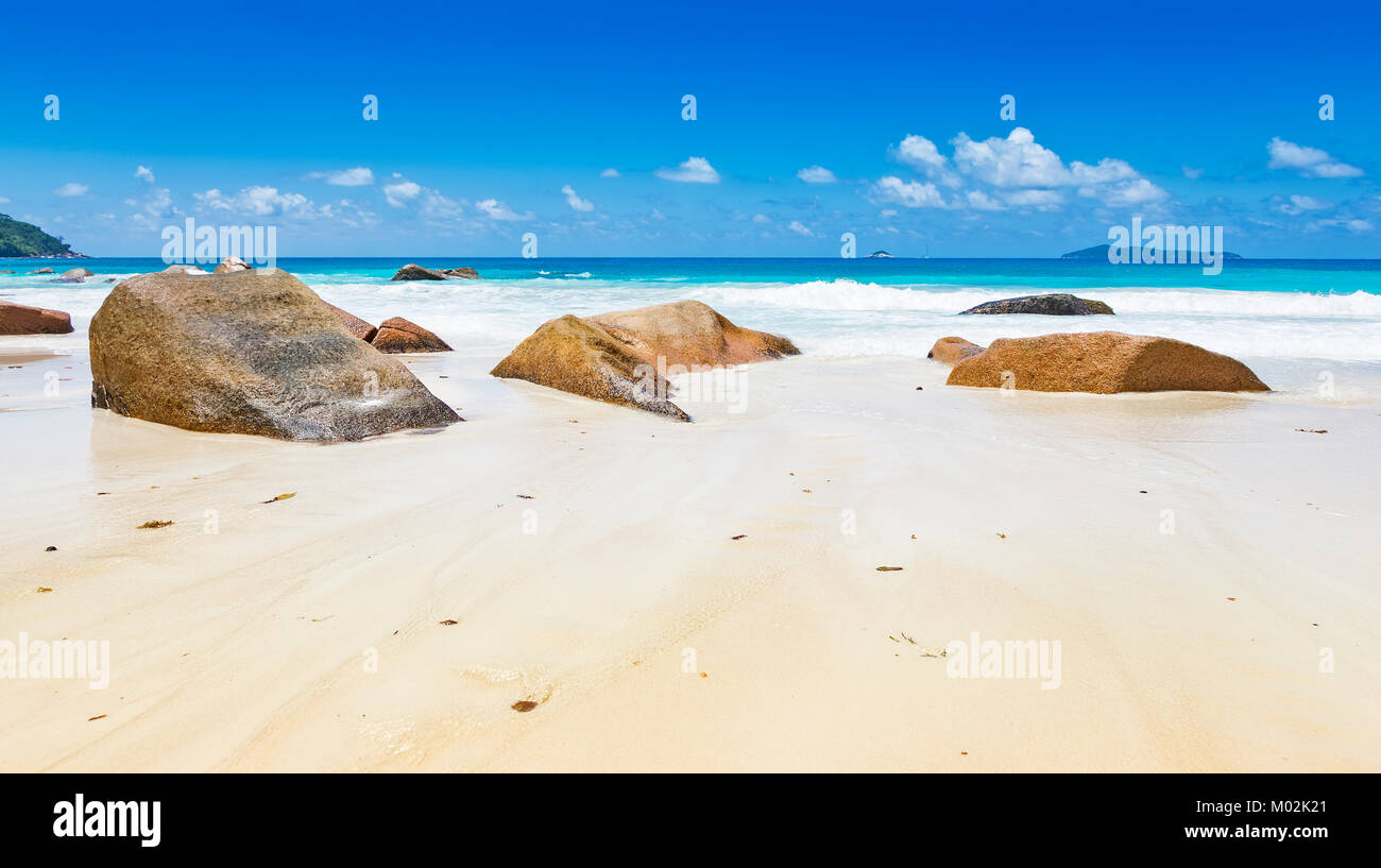 Famous rocks on Anse Lazio tropical island beach, blue sky, golden sand, turquoise ocean, Seychelles islands - Stock Image