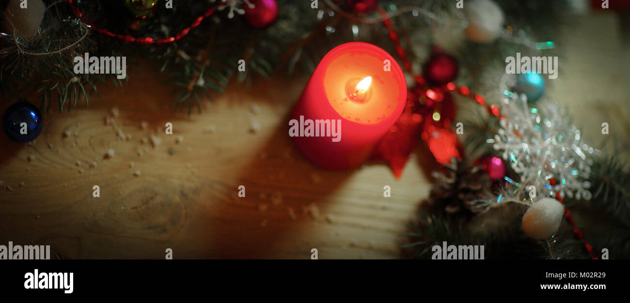 closeupcandle and Christmas wreath on wooden background