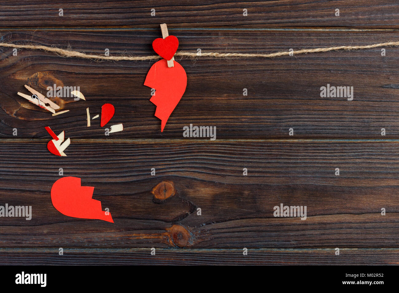Broken heart breakup collection and divorce icon. Red paper shaped as a torn love , health care problems due to - Stock Image
