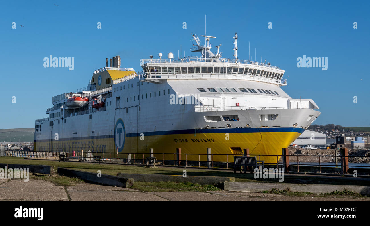 Transmanche Ferry heads down Newhaven Harbour heading for the Channel - Stock Image