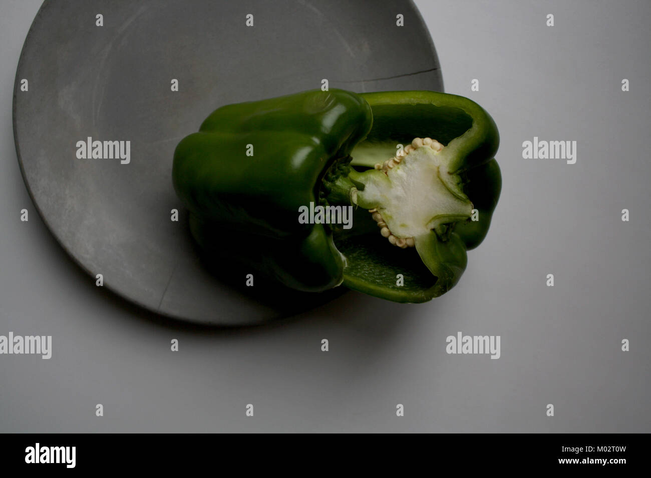 Freshly cut poblano pepper slices isolated on grey concrete plate Stock Photo