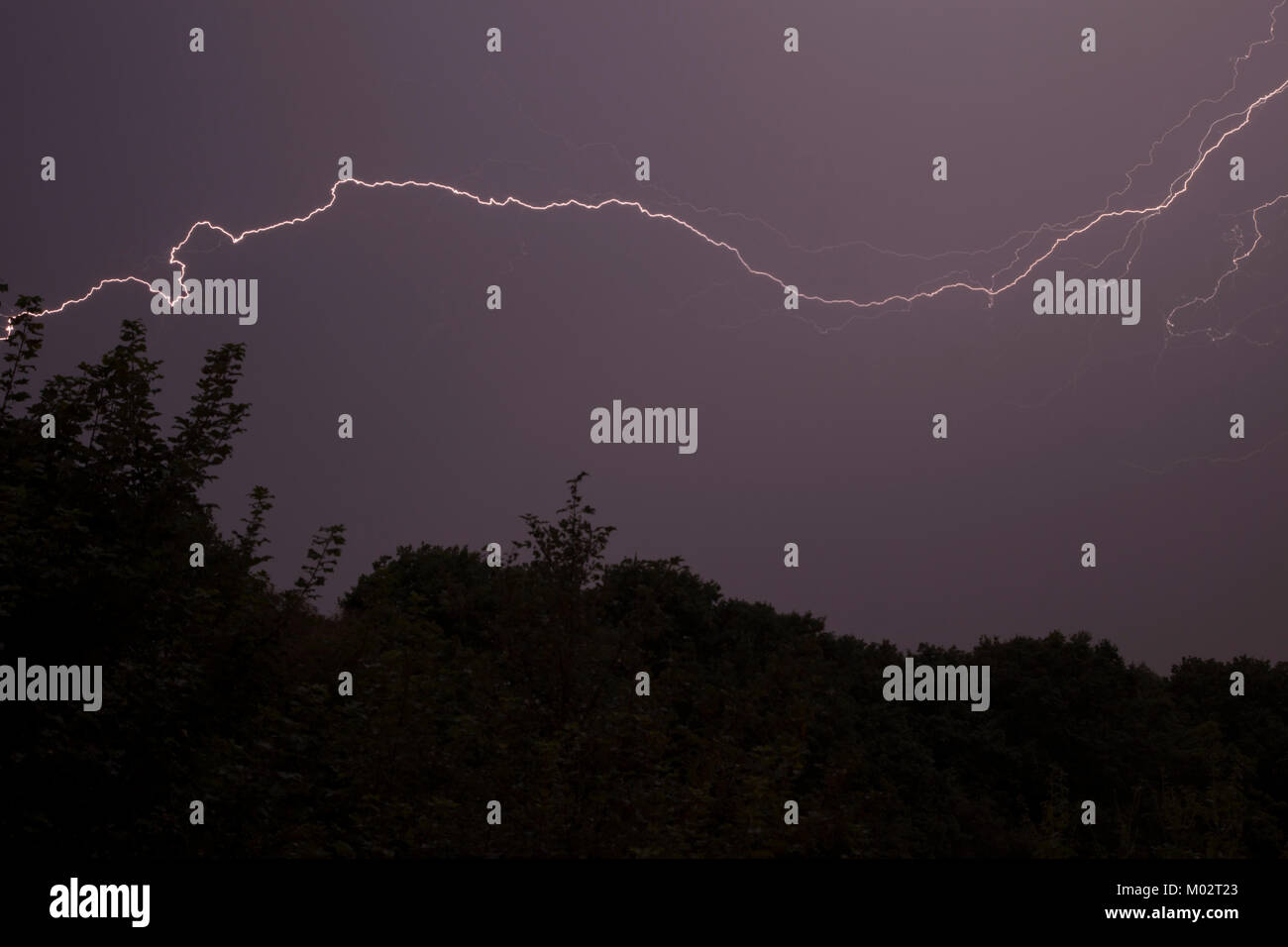 Fork lightning during a thunderstorm in West Yorkshire - Stock Image