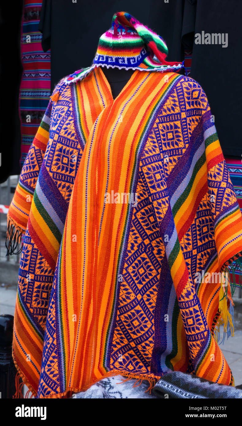 South American colourful poncho and hat, Peru. Traditional patterns and design. - Stock Image