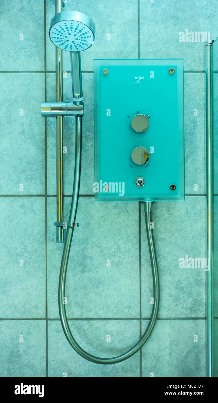Electric shower of 9.8kW. Modern Mira Azora with frosted green glass facia and chrome fittings, against background - Stock Image