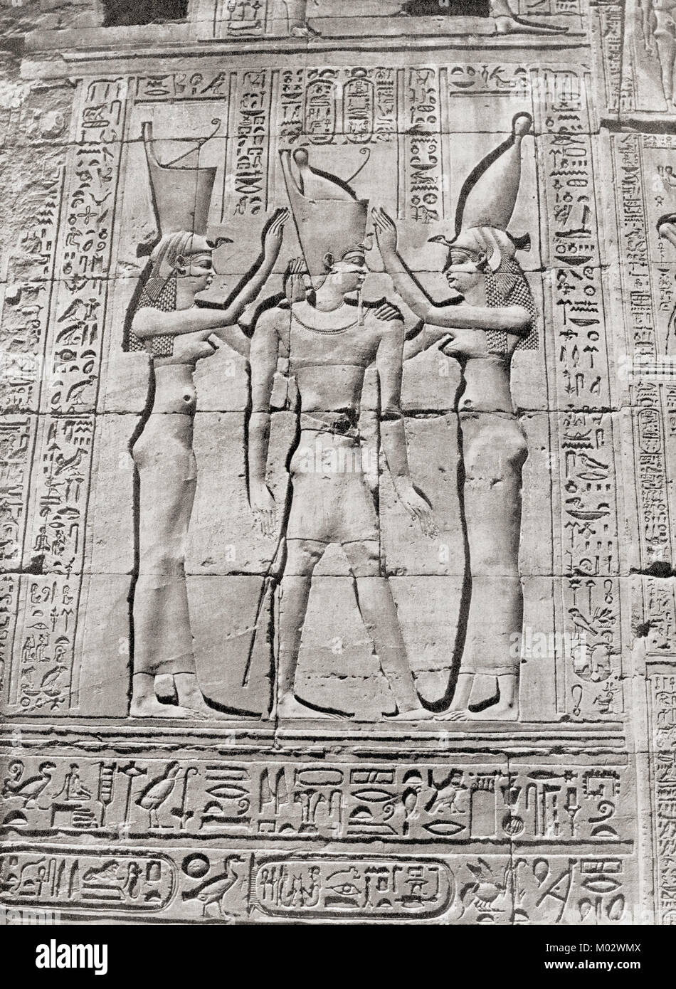 Bas-reliefs on the temple at Dendera, Egypt showing a Ptolemaic Pharaoh being crowned by the goddesses Nekhbet and - Stock Image