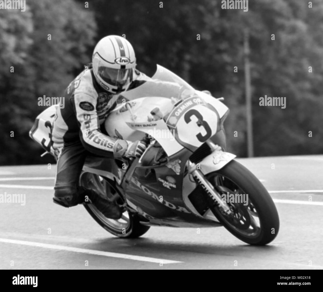 Joey Dunlop on a Honda on his way to winning the Formula 1 TT, June 1988, Isle of Man bhz - Stock Image