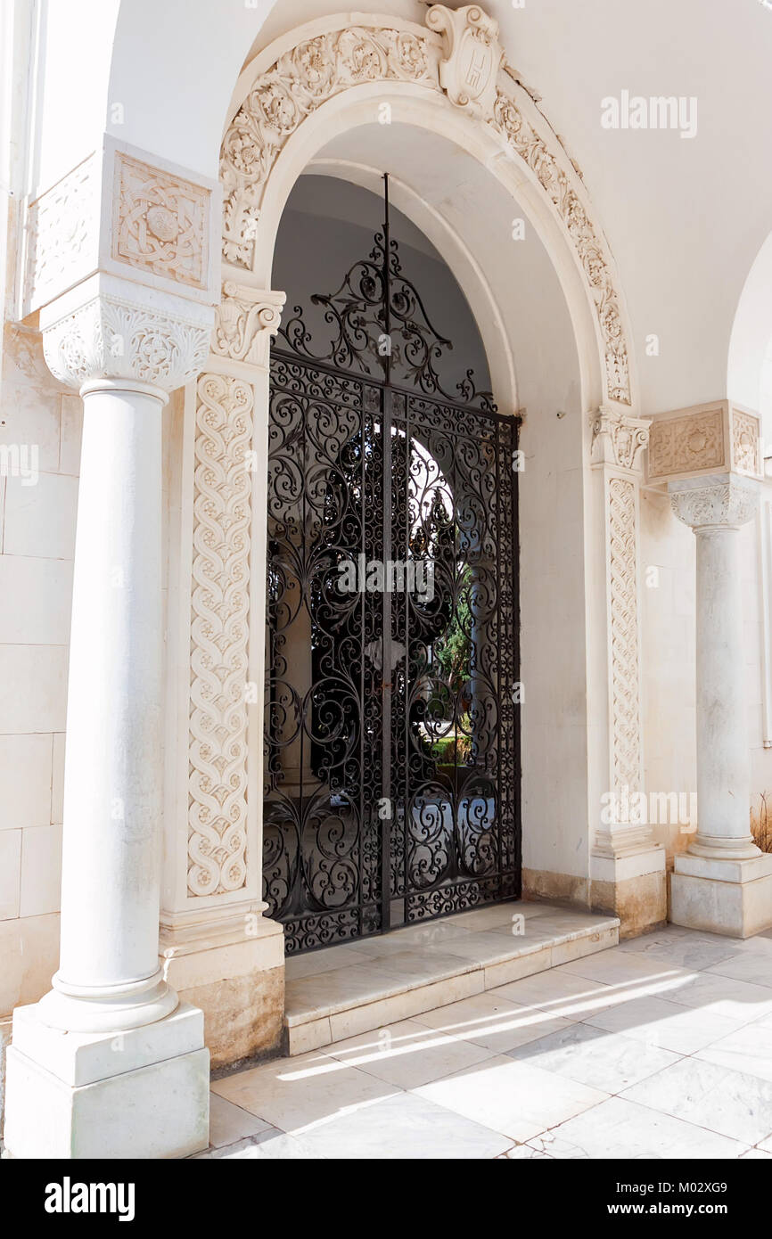 LIVADIA, RUSSIA - MARCH 21, 2011: Black metal gate of Livadia Palace. - Stock Image