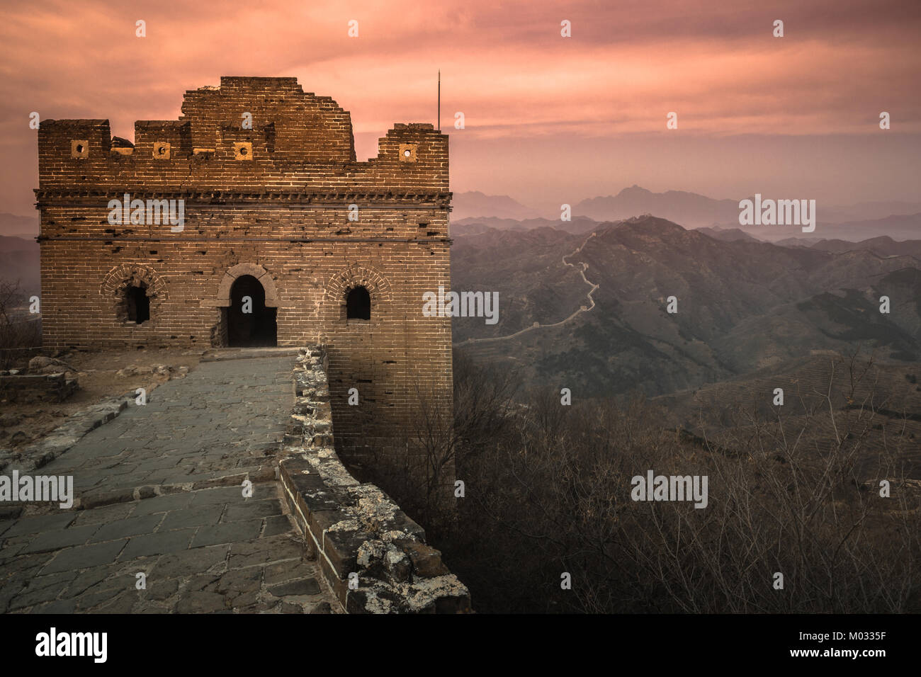 Simatai Great Wall tower over the sunrise - Stock Image