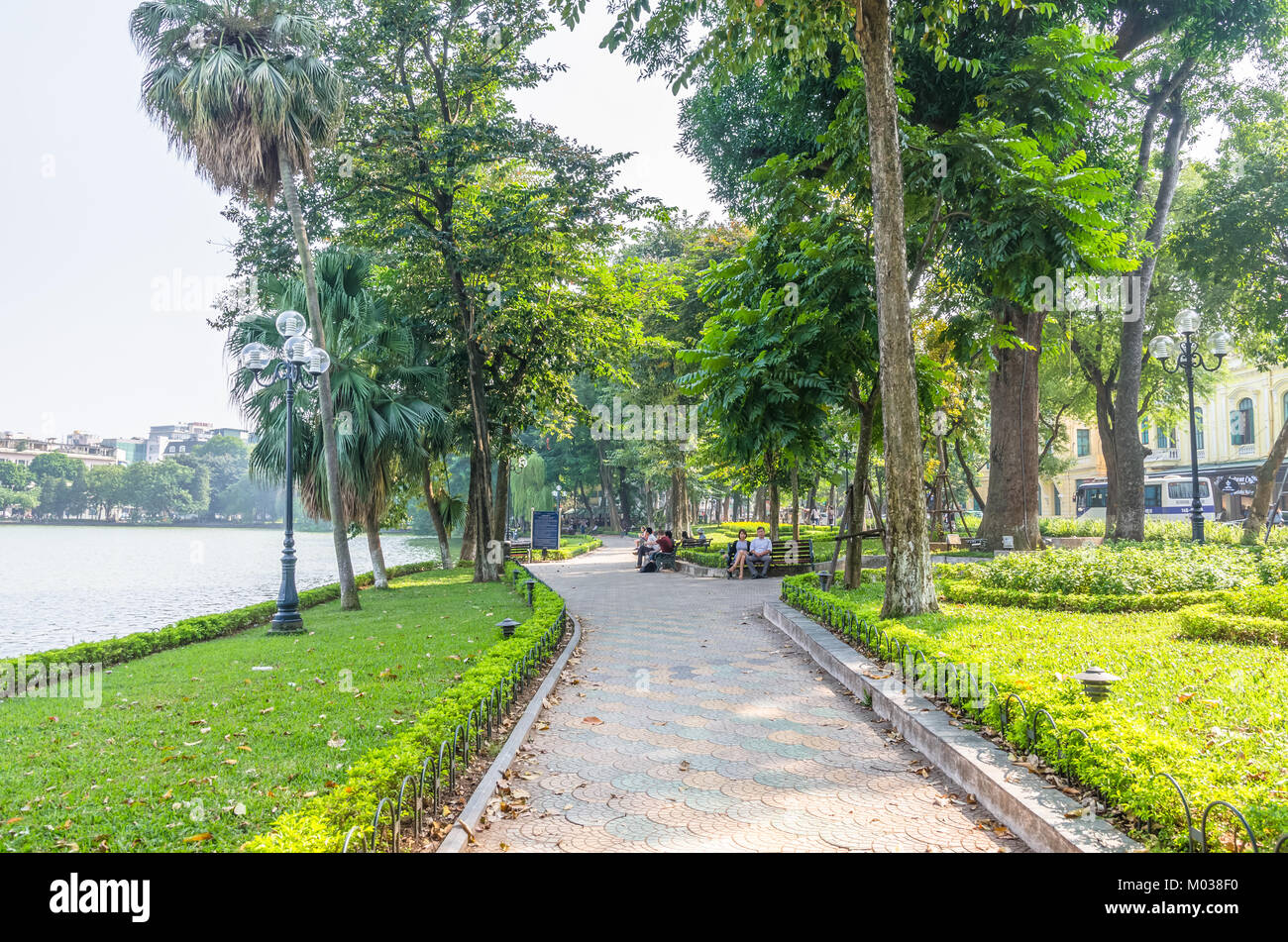 Hanoi,Vietnam - November 2,2017 : Scenic view of the lakeside of Hoan Kiem Lake, people can seen relaxing and exploring - Stock Image