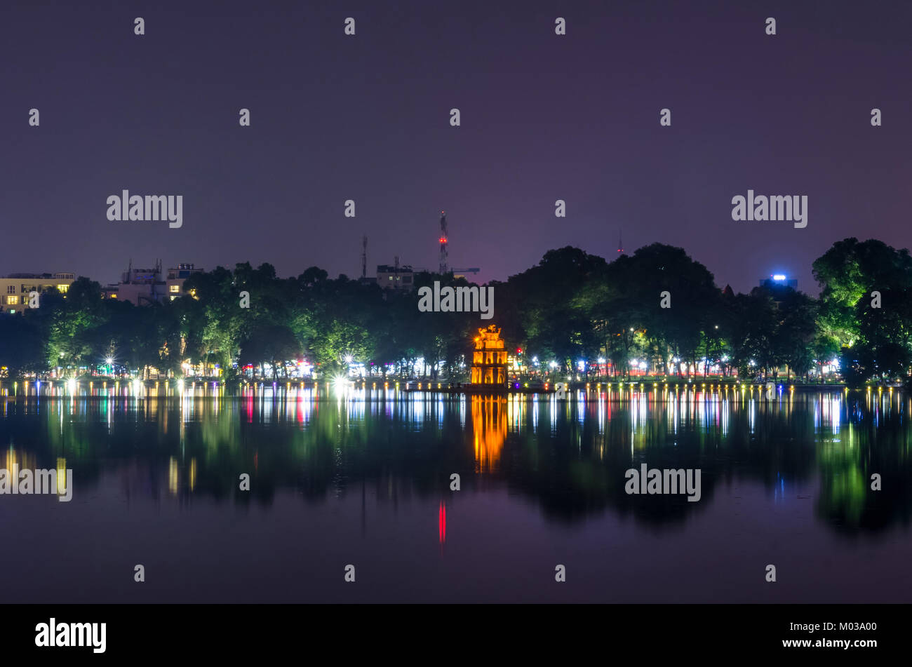 Night view of Turtle Tower or Tortoise tower which is located in the middle of the Hoan Kiem Lake. Hoan Kiem Lake - Stock Image