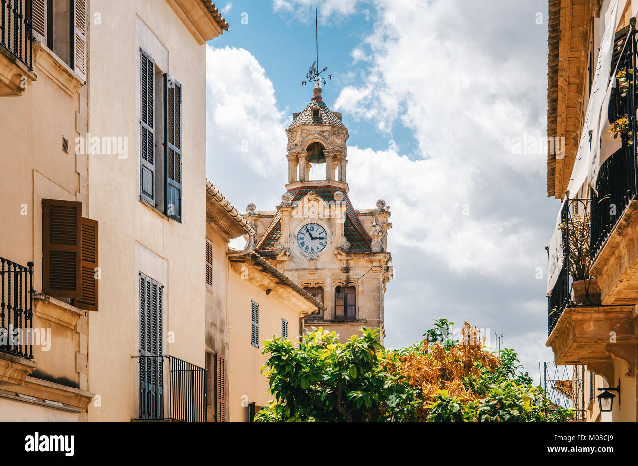 Architecture of Majorca. The tower with big clock of City town hall in Old Town of Alcudia, Mallorca, Balearic island, Stock Photo