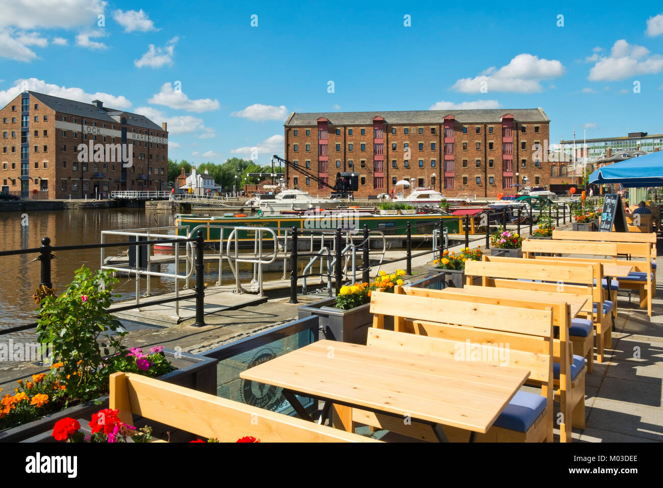 Gloucester, UK - 18th July 2016: Waterside cafes and restaurants wait ready for customers, Gloucester Docks, Gloucester, - Stock Image