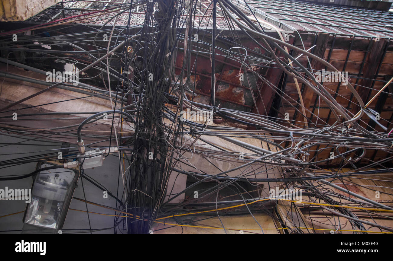 Messy electric wiring on the pole in Hanoi,Vietnam. - Stock Image