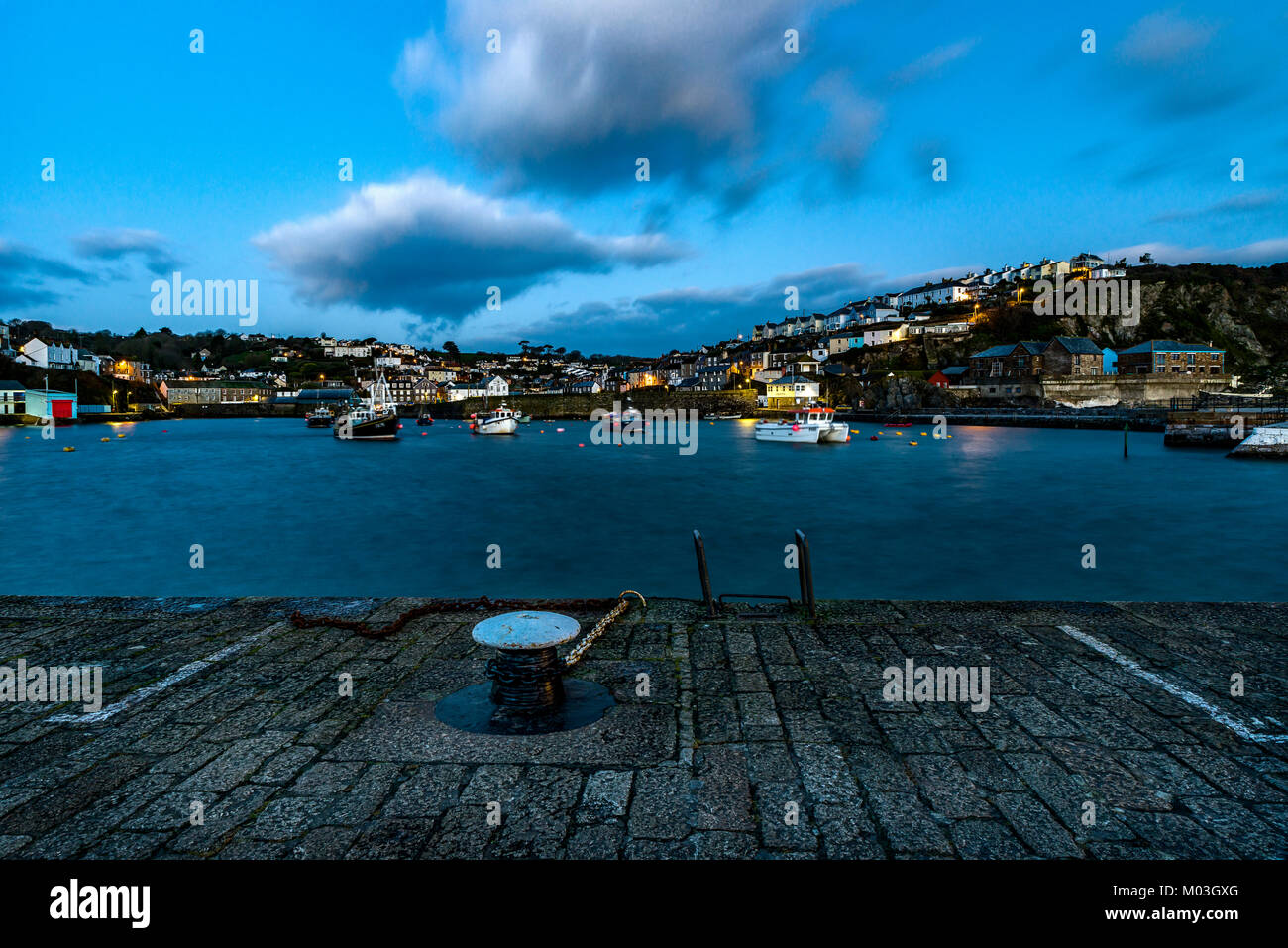 Mevagissey Harbour, St Austell, Cornwall, UK. The morning after Storm Fione the sunrise was a welcome change from - Stock Image