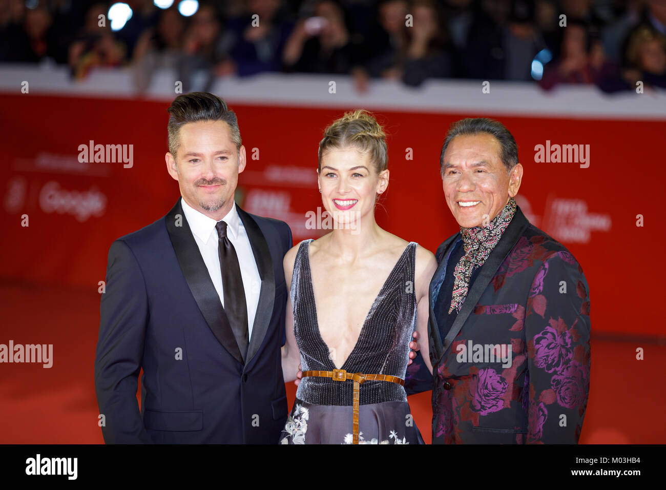 Rome, Italy - October 26, 2017: Rosamund Pike (center), Scott Cooper (left), and Wes Studios on the red carpet of - Stock Image