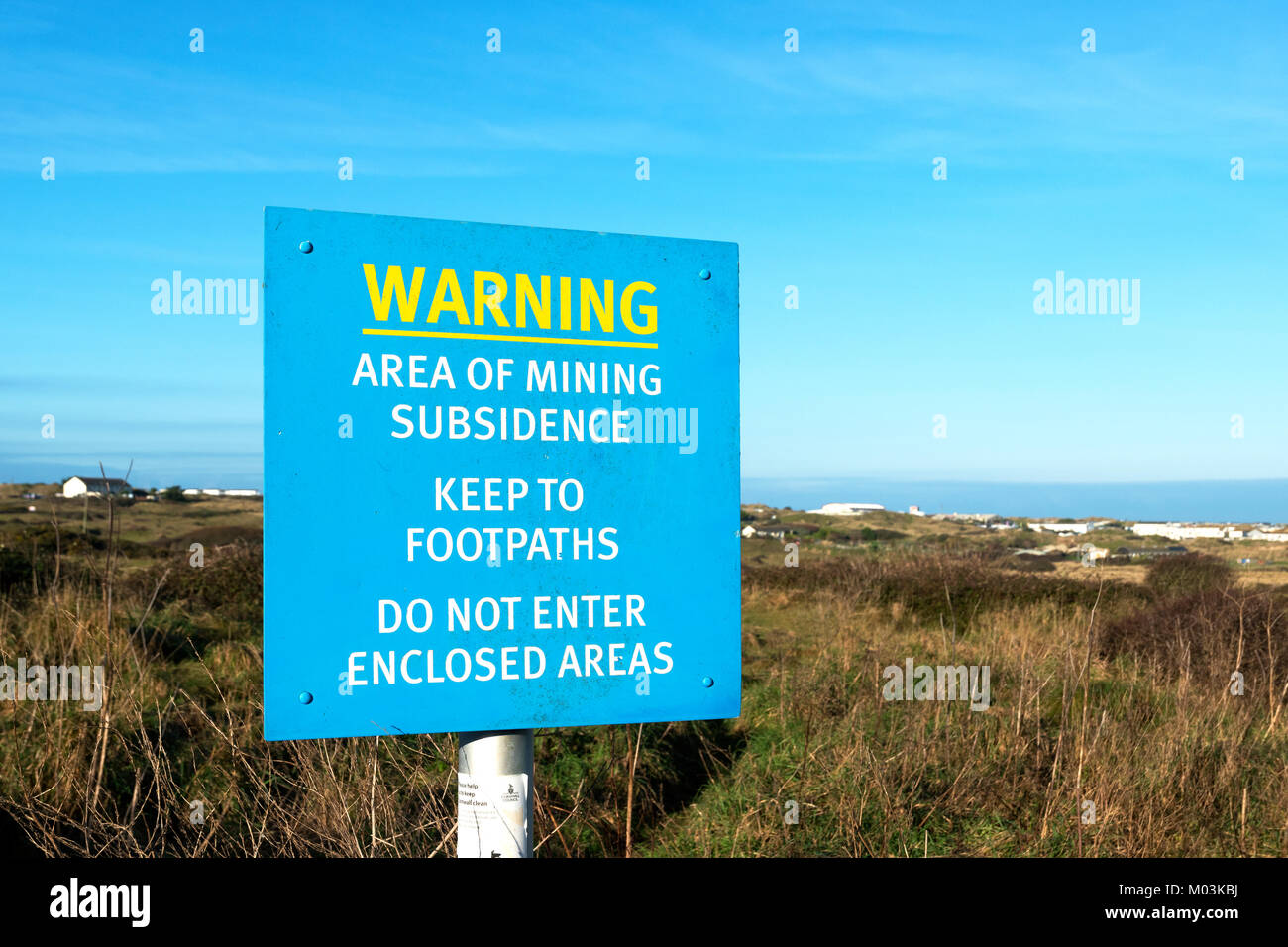 mining subsidence warning sign near perran sands, perranporth, cornwall, england, uk. - Stock Image