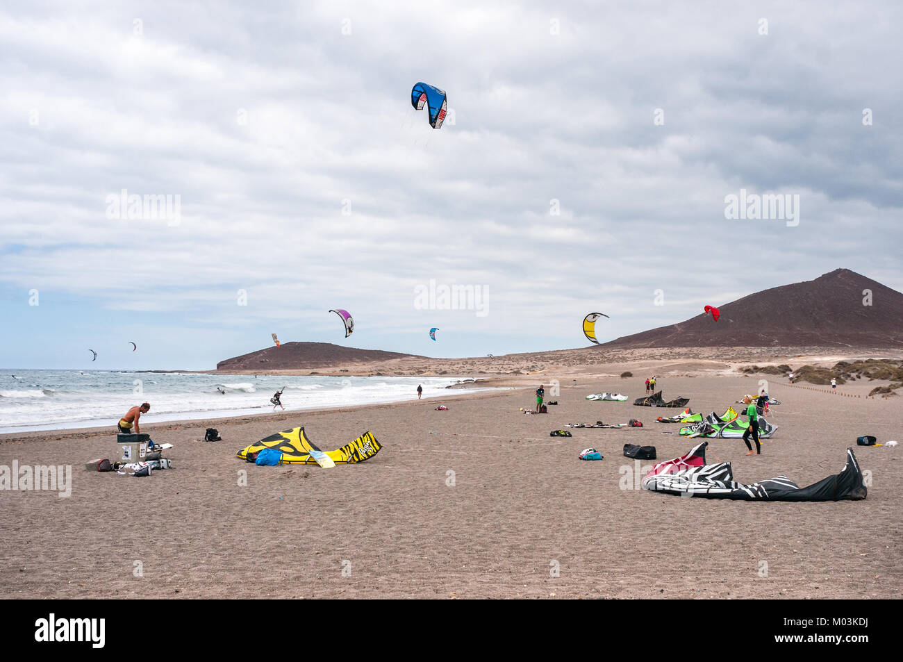 Kitesurfers on El Médano beach on an overcast windy day, Tenerife, Spain - Stock Image