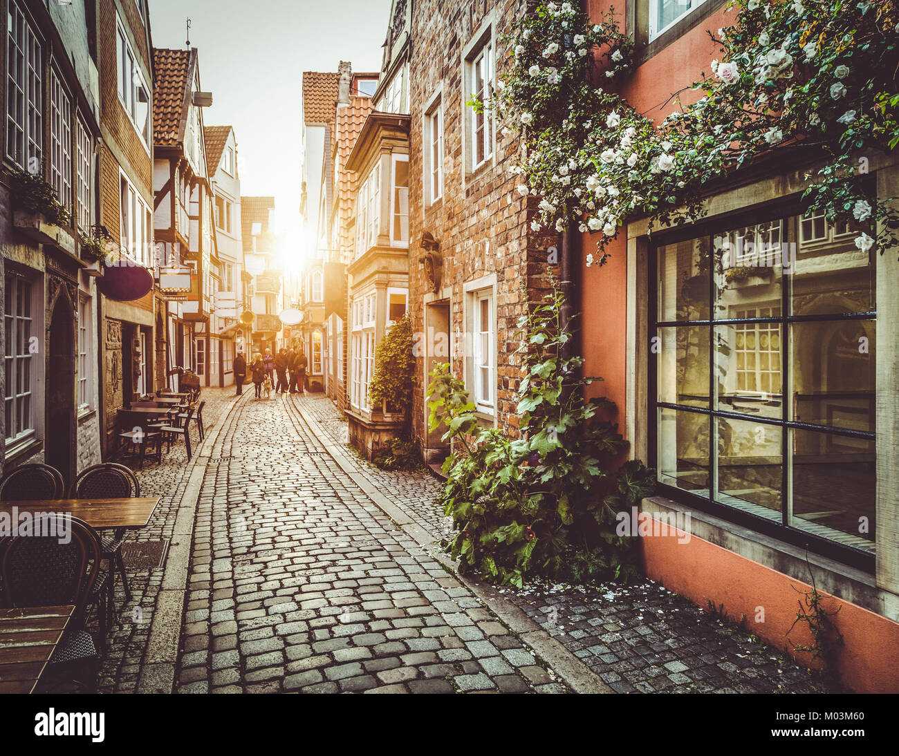 Old town in Europe at sunset with retro vintage Instagram style filter and lens flare effect - Stock Image