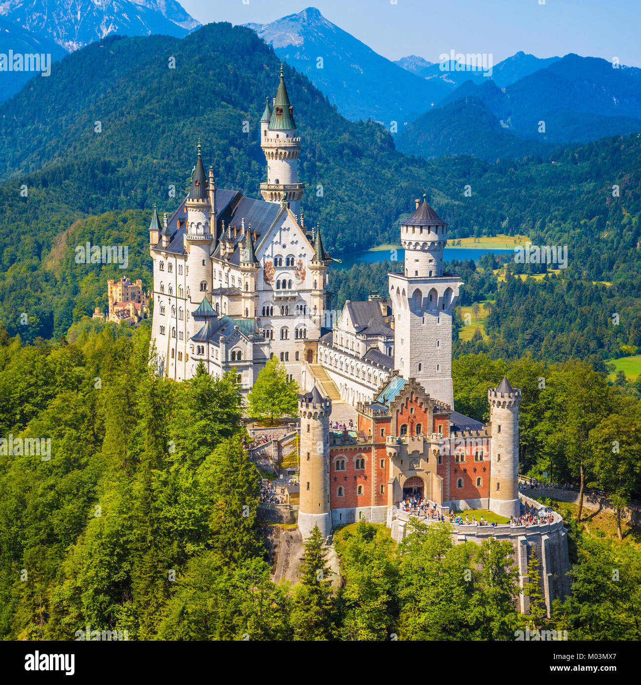 Beautiful view of world-famous Neuschwanstein Castle, the nineteenth-century Romanesque Revival palace built for - Stock Image