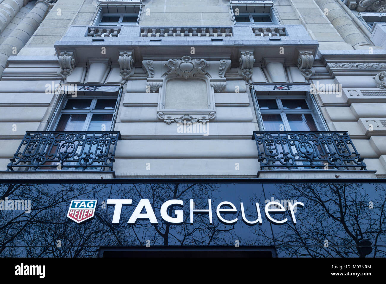 PARIS, FRANCE - DECEMBER 20, 2017: Tag Heuer logo on their main shop on Champs Elysees avenue. TAG Heuer is a Swiss - Stock Image