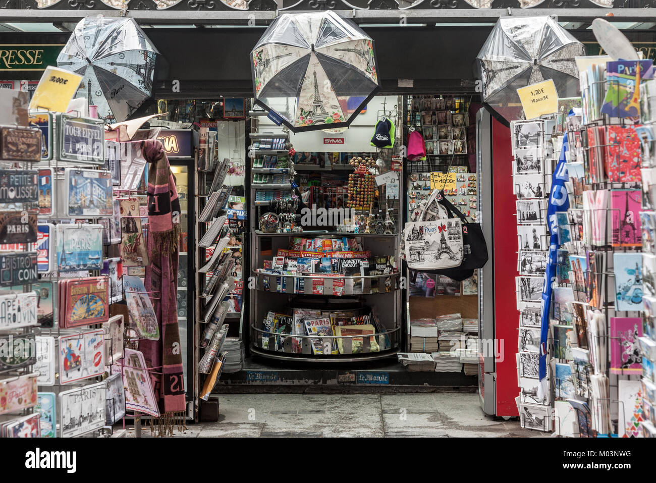 PARIS, FRANCE - DECEMBER 20, 2017: Souvenir Shop on the Paris avenue of Champs Elysees, in a kiosk, displaying various - Stock Image