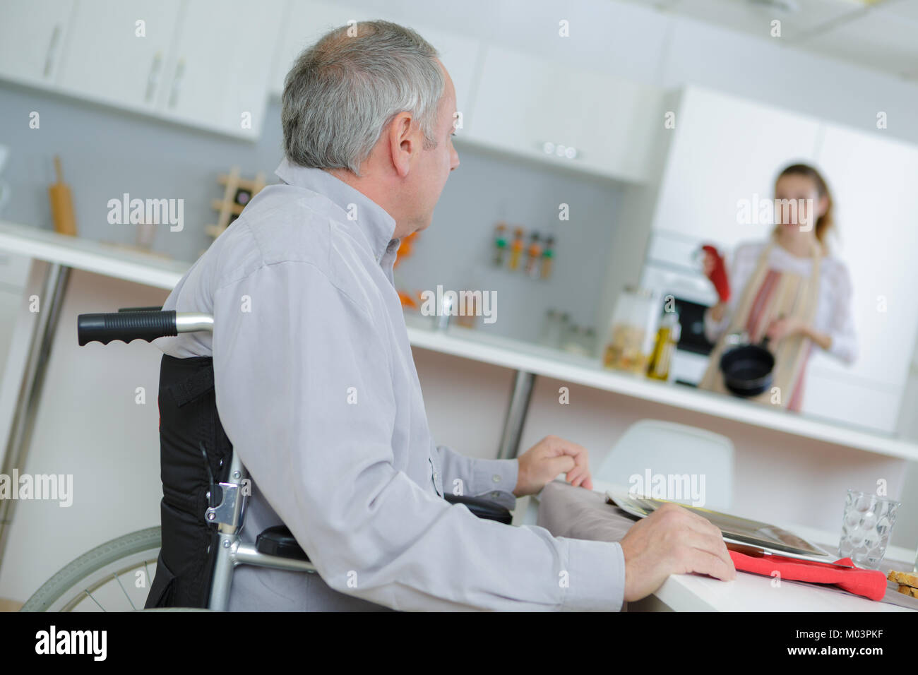service for the handicapped old man - Stock Image