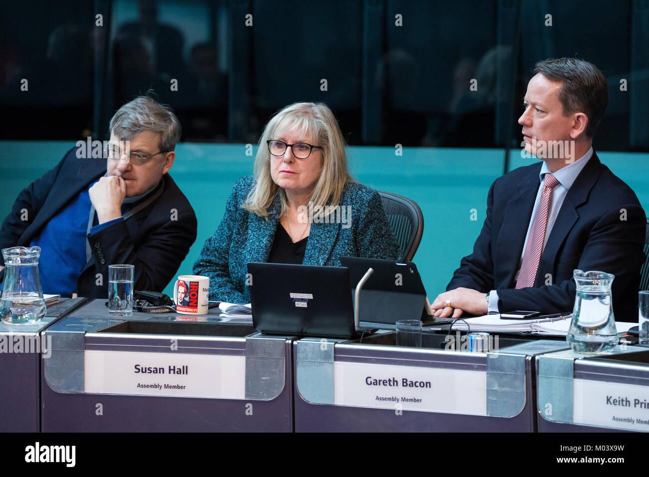 London, UK. 18th Jan, 2018. Tony Devenish, Susan Hall and Gareth Bacon, Conservative London Assembly Members, listen - Stock Image