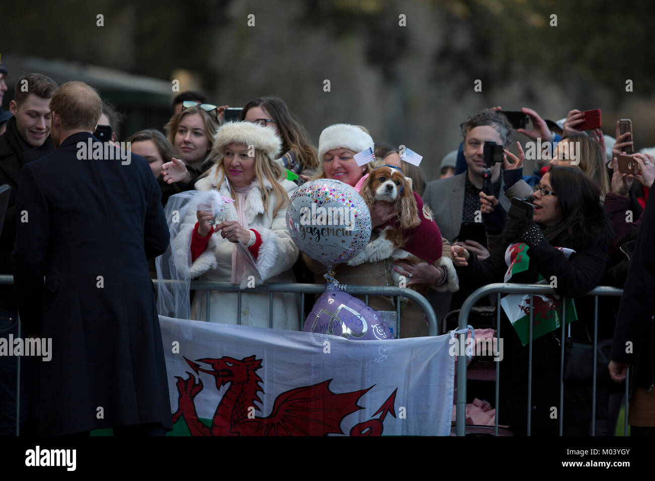 Cardiff, UK. 18th Jan, 2018. eager crowds greet Prince Harry and Ms Meghan Markle on their royal engagement tour Stock Photo