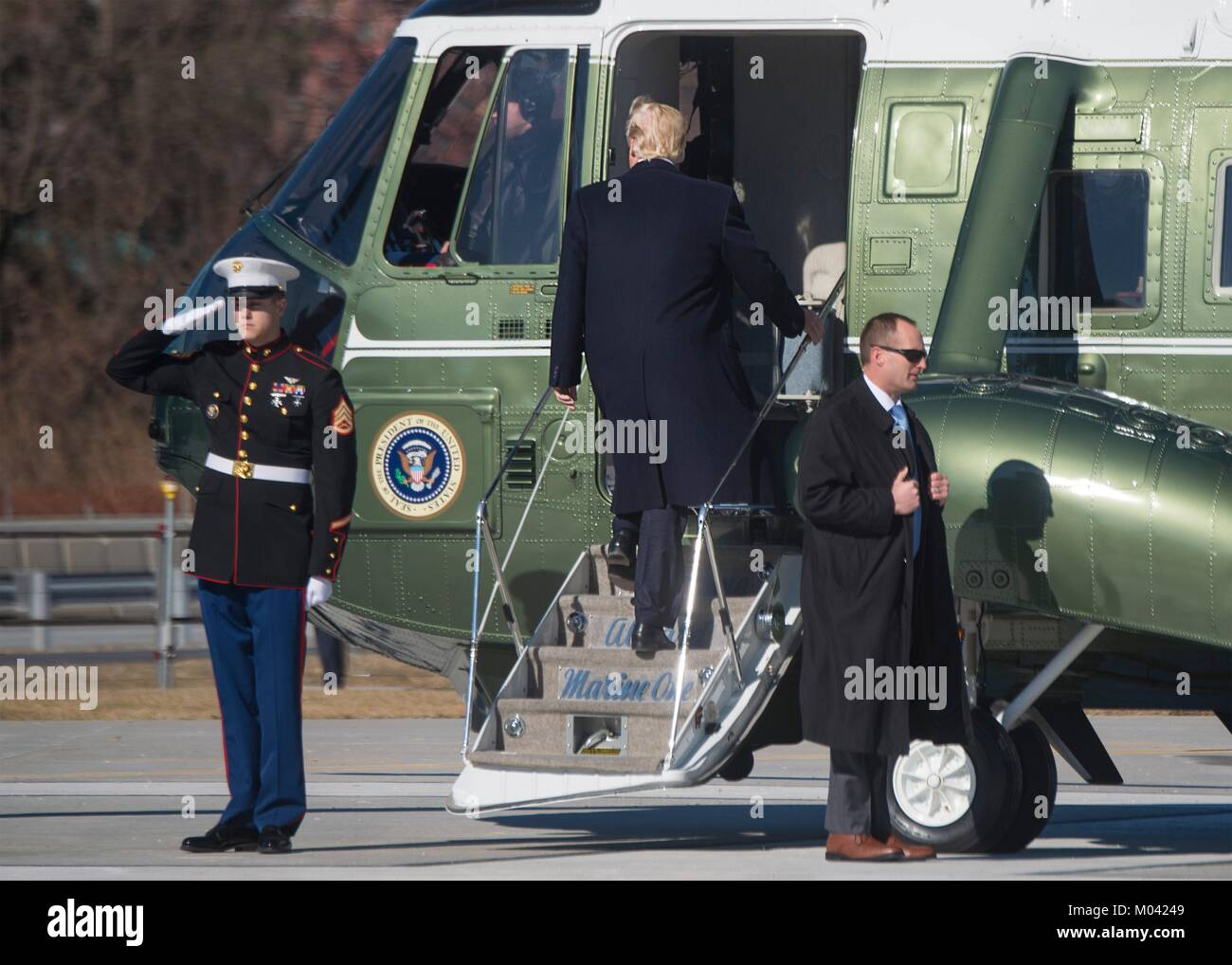 Arlington, United States Of America. 18th Jan, 2018. U.S. President Donald Trump boards Marine One helicopter following - Stock Image